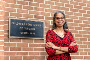 Nadine Marsh-Carter, CHS President, smiling standing in front of office | adoption in the 2010s